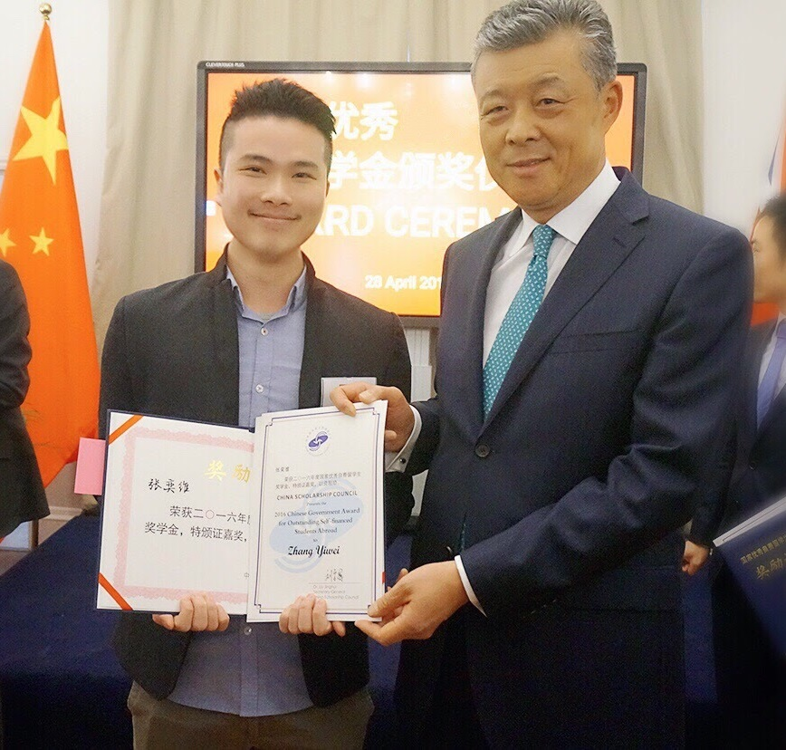Yiwei Zhang receives 2016 Chinese Government Award from the Chinese ambassador, Xiaoming Liu.