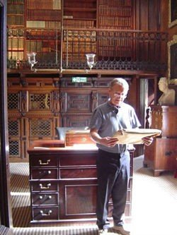 Professor Douglas Gifford (honorary Librarian of Walter Scott's Library) looks through materials in Scott's study (where most of the Waverley novels were written!)
