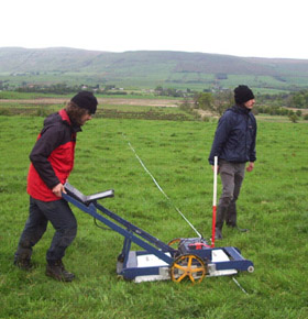 John Malcolm and Olly O'Grady with the Utsi Groundview ground penetrating radar, at Auchendavy on the Antonine Wall, summer 2007
