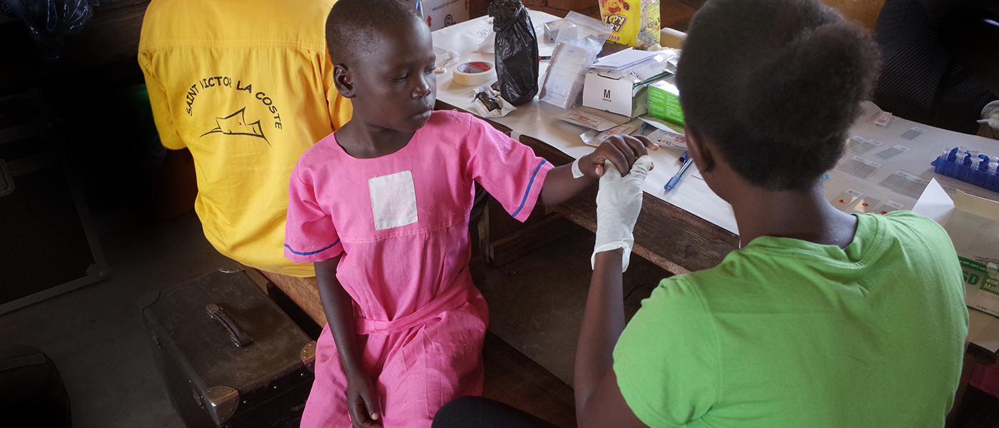 Finger prick blood test at a Ugandan clinic