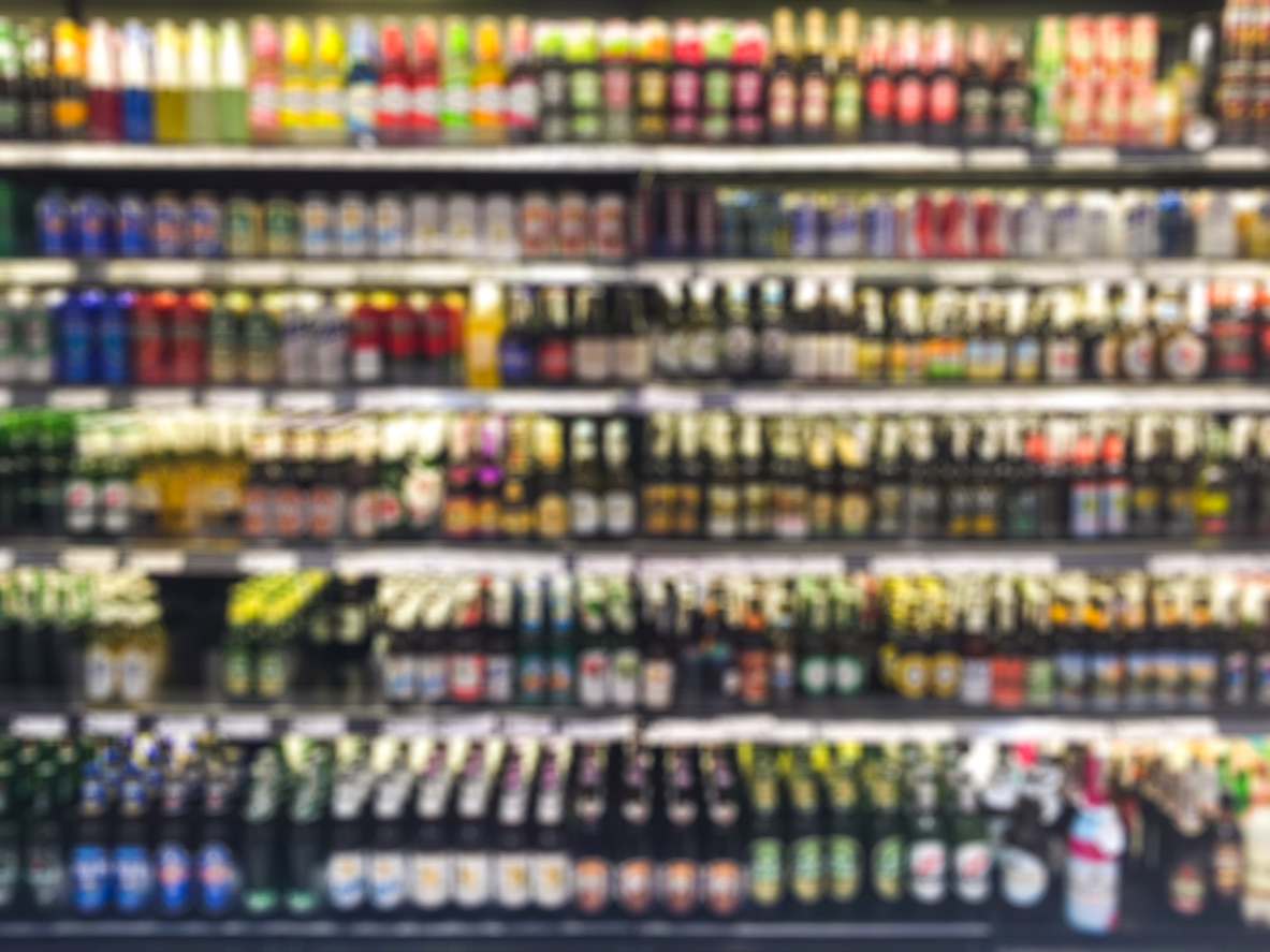 Blurred photo of alcohol bottles on a shop shelf