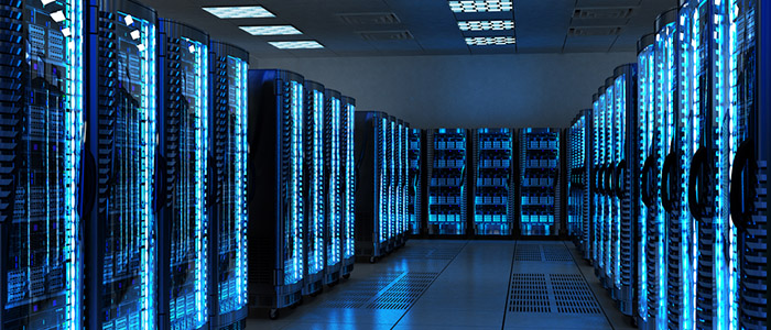 Image of many data servers in a brightly lit server room