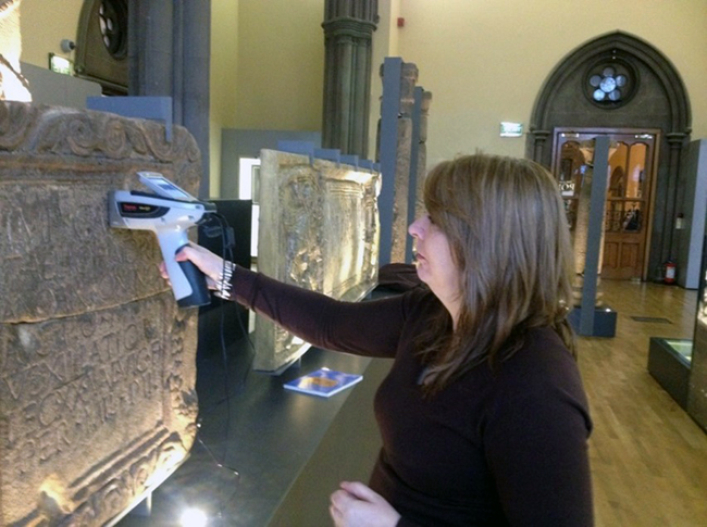 Dr Louisa Campbell, using a p-XRF machine on The Hunterian Roman stones