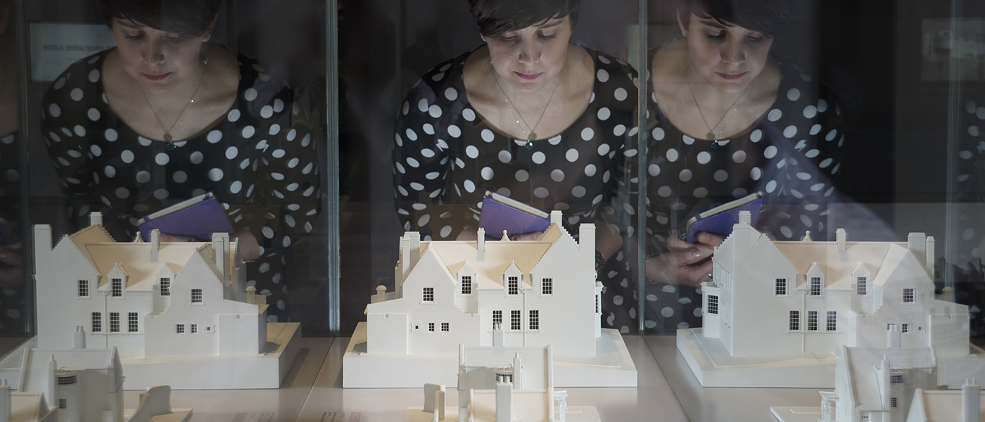 Student with Charles Rennie Mackintosh models.