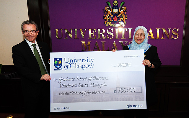 Image of the ceremony to agree a dual-degree programme from the Adam Smith Business School and Universiti Sains Malaysia (USM) Graduate School of Business (GSB).