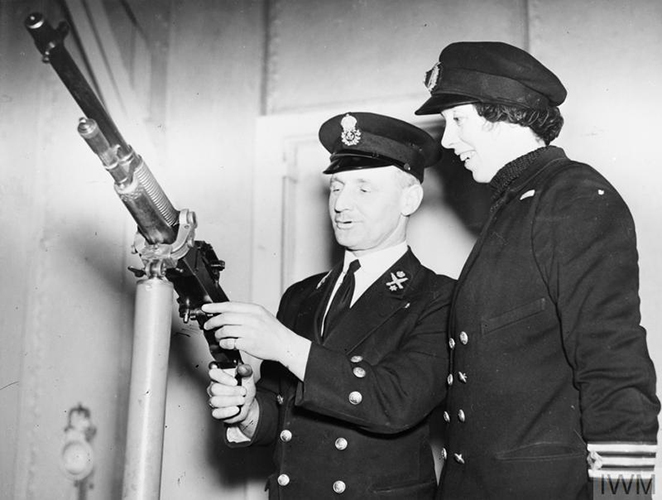 2nd Engineer Miss Victoria Drummond, MBE, MN, receiving instruction on components of a machine gun. © IWM (A 7841A)
