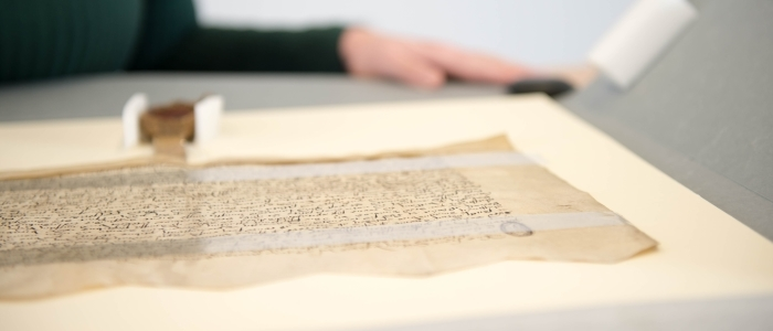 An ancient manuscript on a desk in the Hunterian