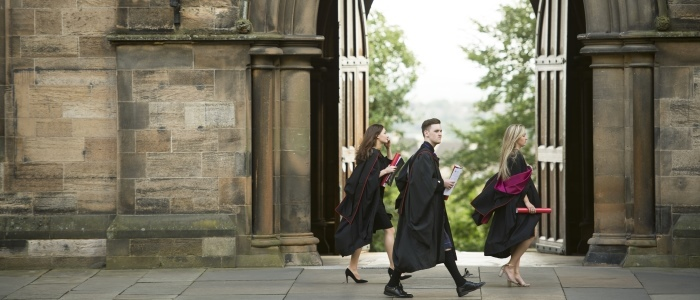 Students walking through the quadrangle during graduation