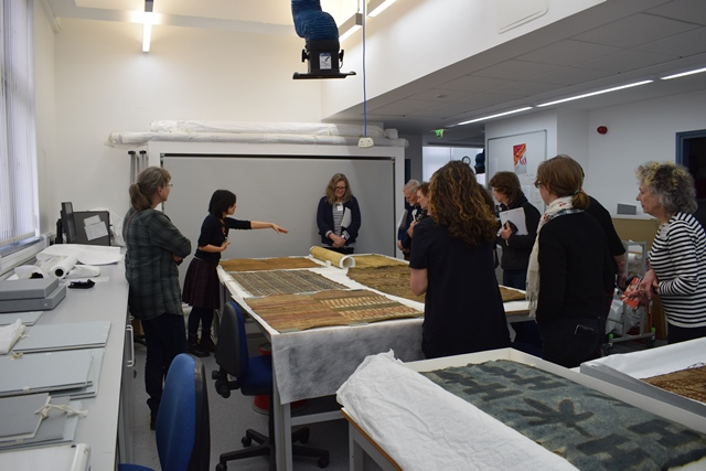 A group of UofG staff, students and conservators at barkcloth workshop with expert American Samoans