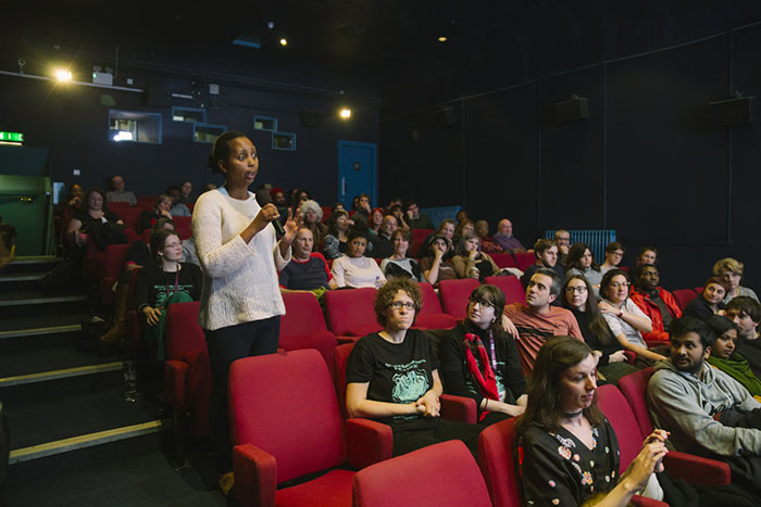 An audience member asks a question at an Africa in Motion screening