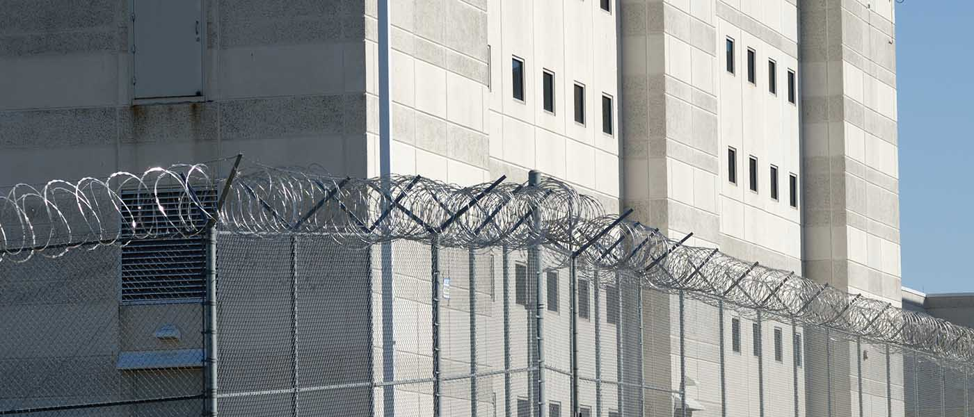 External shot of a US prison showing fencing