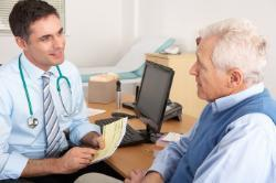 Photo of older man consulting with GP