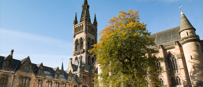 Photo of University of Glasgow main building against blue sky