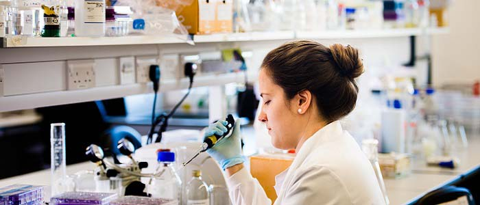 Image of female student working in a lab