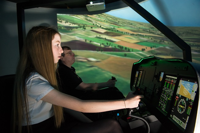 Professor George Barakos and Clydebank High School pupil Katie Buist inside the flight simulator at UofG