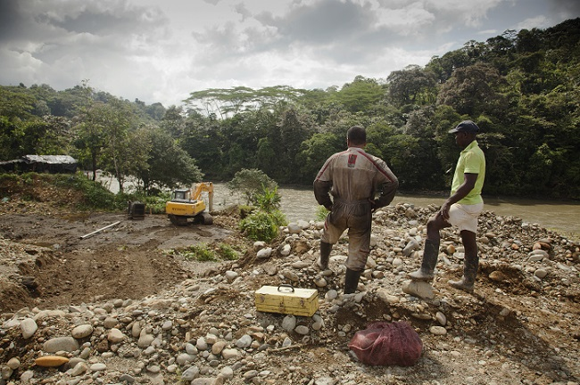 A photo of the Colombia River Stories project featuring people mining on a river