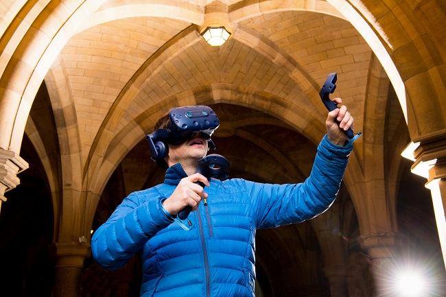 Photo of Dr Neil McDonnell in Cloister for the announcement of funding for Virtual Reality Classrooms and Teaching Resources to be created by University of Glasgow. 650