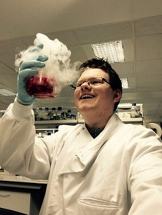 PhD Student Testimonials - photo of student in lab