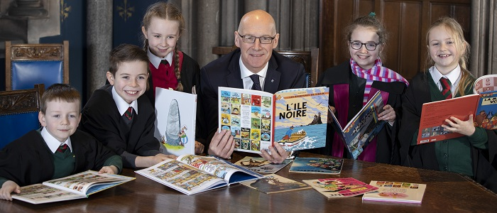 Pupils from St Patrick's Primary joins Deputy First Minister John Swinney to launch new education resources created from UofG researcher.