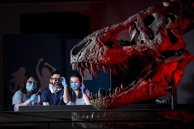 Dentist lecturer Jamie Dickie and dental students Sophie James (left) and Kirsty Harrower (right) with Trix the T.rex at the official opening for the T.rex in Town exhibition at Kelvin Hall