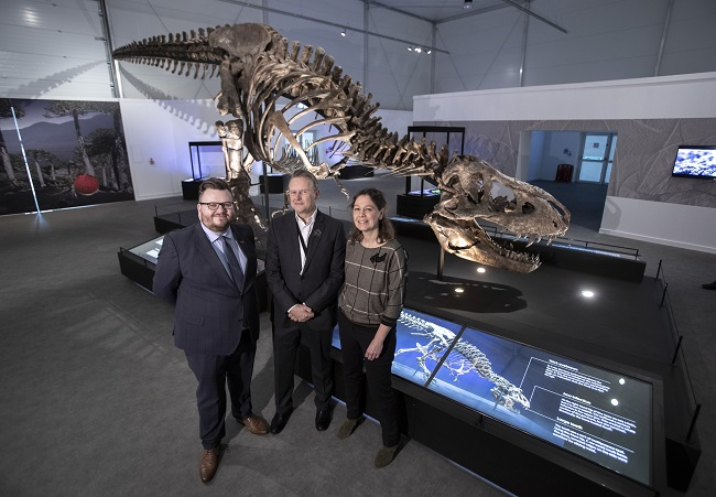 Left to Right Cllr David McDonald; Steph Scholten, and Caroline Bruenese with Trix the T.rex at the official opening for the T.rex in Town exhibition at Kelvin Hall