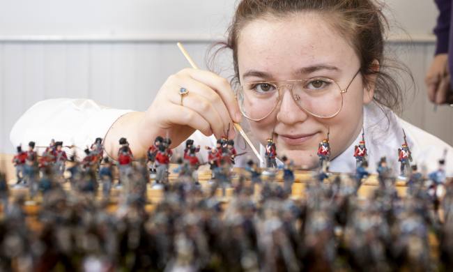 Lucy Wallace, S3 Pupil, Clydebank High School, helping to paint some of the 22,000 28mm figures to be used in The Great Game: Waterloo Replayed which will be  the biggest ever historical table top war game. Photo Credit Martin Shields
