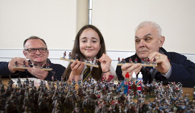 Steve Wyllie (left), an Army veteran with Model Making Group at Erskine and  Robert McCreadie (right) from Dumbarton, a Royal Navy veteran and volunteer who runs the Model Making Group at Erksine, are joined by Millie Wallace, S1 pupil from Clydebank High School to help to paint some of the the 22,000 28mm figures to be used in The Great Game: Waterloo Replayed Photo Credit Martin Shields