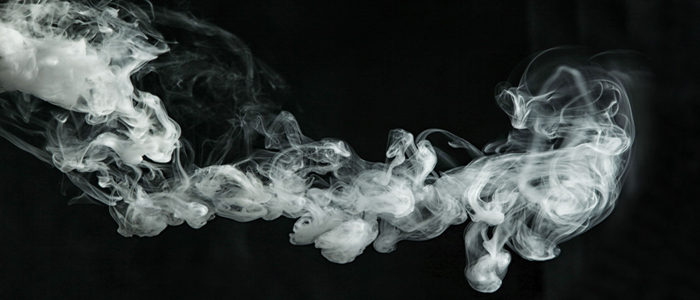 Image of smoke drifting across a black background