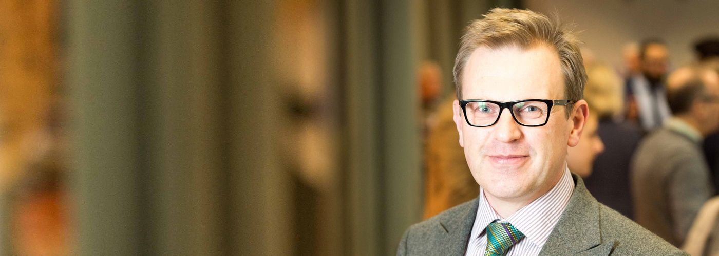 Photograph of Professor John Finch, Head of Adam Smith Business School, from the 'Our MBA at 40' event