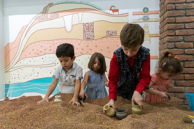 Children using the new museum space in an Iraqi museum created in conjunction with University of Glasgow archaeologists