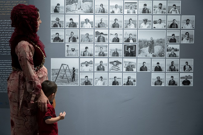 A photo of a mother and child in a new museum space created in Iraq in conjunction with University of Glasgow archaeologists