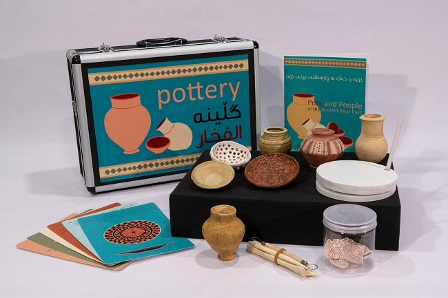 A photo of a pottery school box resource for children in Iraq created to help them understand their history with support from University of Glasgow archaeologists