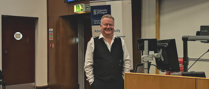 Simon Guild front of lecture theatre at 2019 Induction