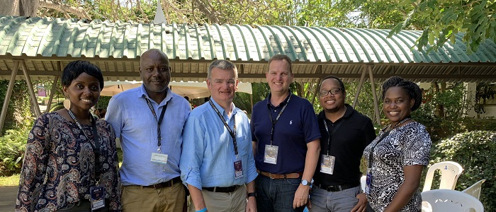The Institute's Prof iain McInnes and Prof Paul Garside stand with AfrIBOP attendees in Kalifi, Kenya