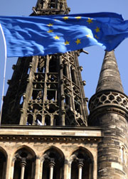 The University tower with an EU flag flying