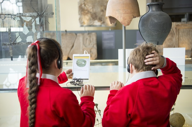 Children using ipads in a museum as part of the EMOTIVE project which allows users to imagine what life might have been like hundreds of years ago through the power of Virtual Reality/Augmented Reality technology and digital storytelling