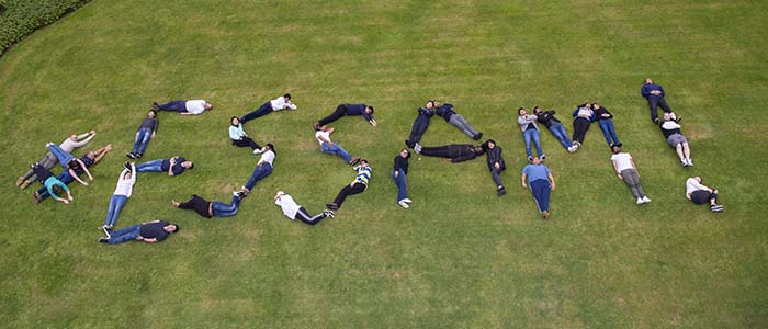 Aerial photo of students spelling out #ESSAM! with their bodies on grass