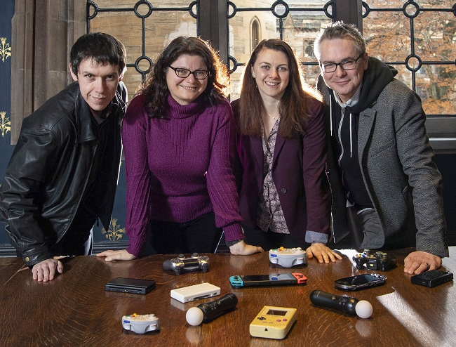 Photo caption left to right: Dr Timothy Peacock , Lecturer in History; Dr Dimitra Fimi, Lecturer in Fantasy and Children's Literature ; Dr Jane Draycott , Lecturer in Classics , and Dr Matthew Barr, Lecturer in Computing Science who are co - directors and co - founders of the University of Glasgow's Games and Gaming La