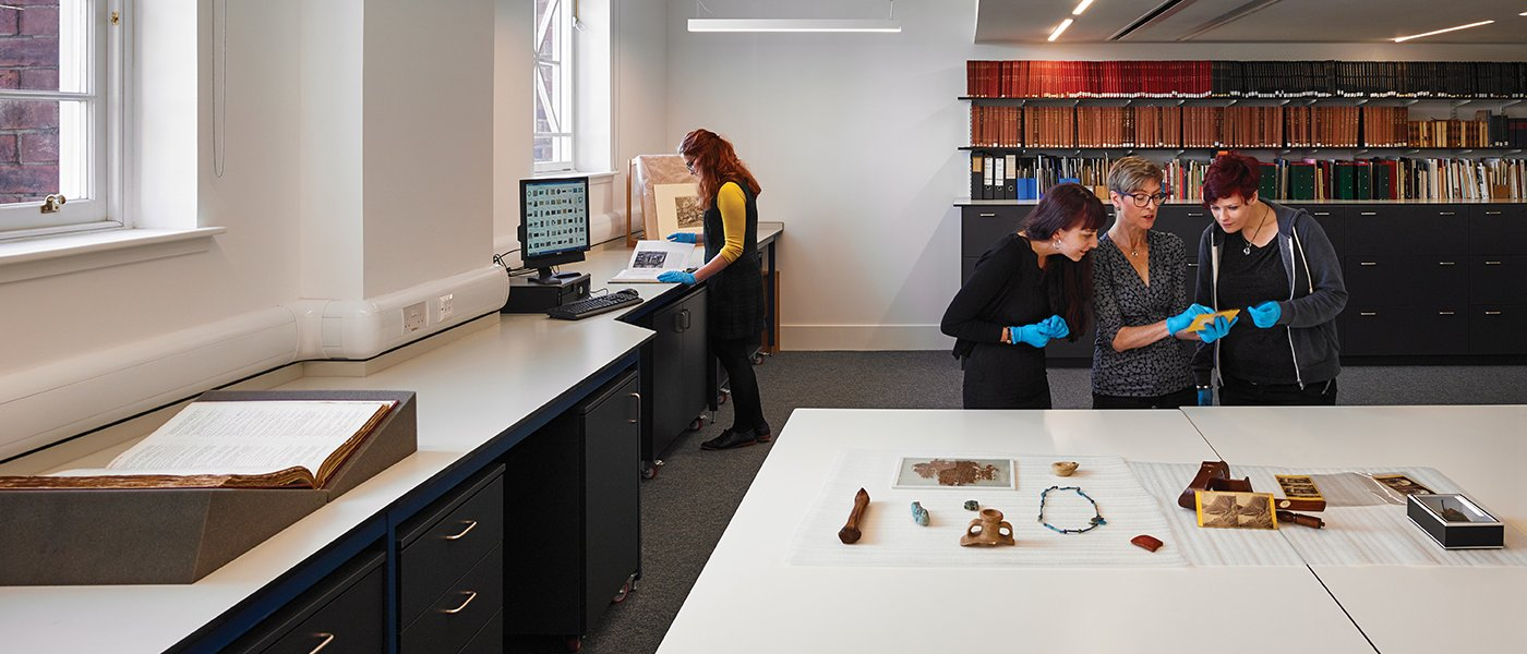 Researchers and students examine pieces from our collections in Kelvin Hall. Photo: Andrew Lee.