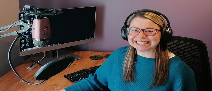 Image of Sharon Wright sitting at her computer